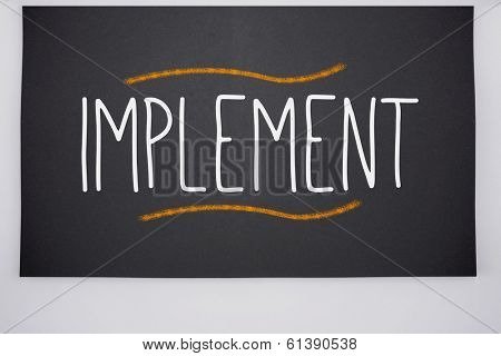 The word implement written on big blackboard
