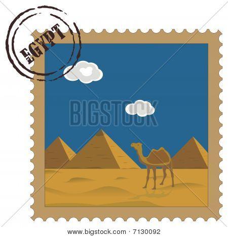 Old vintage postal stamp with Egyptian pyramids, famous landmark
