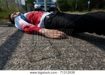 Dead Man Lying On The Street