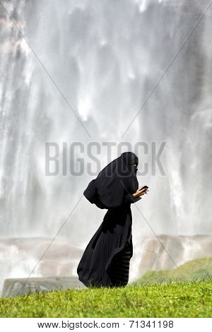Islamic Woman Using A Smartphone