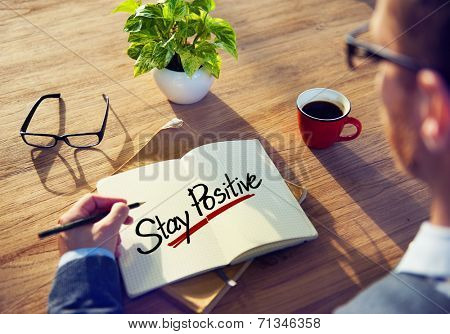 Man with a Note and a Single Word Stay Positve