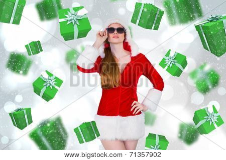 Cool santa girl wearing sunglasses against white glowing dots on grey poster
