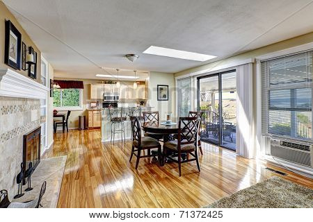 Spacious Dining Area With Round Counter Top Table And Chairs