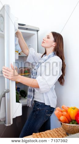 Young Woman Looking For Something In The Fridge