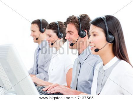 Joyful Customer Service Agents Working In A Call Center