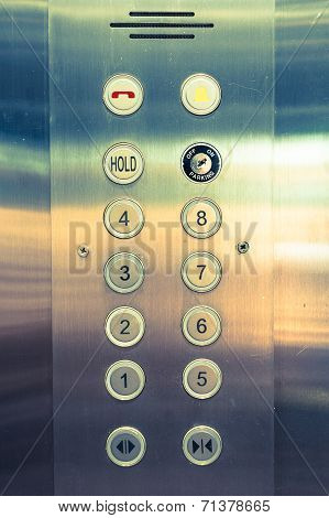 silver elevator panel have number 1 to 8 floor on it poster
