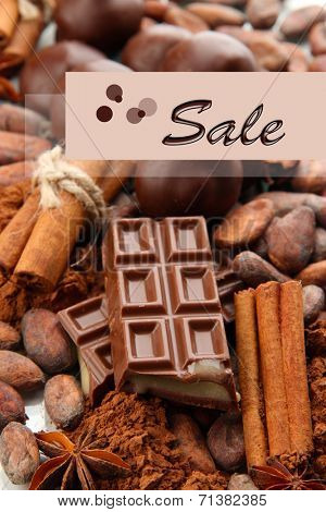 Concept of discount. Composition of chocolate sweets, cocoa