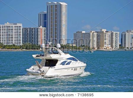 Small White Yacht and Miami Beach Condos