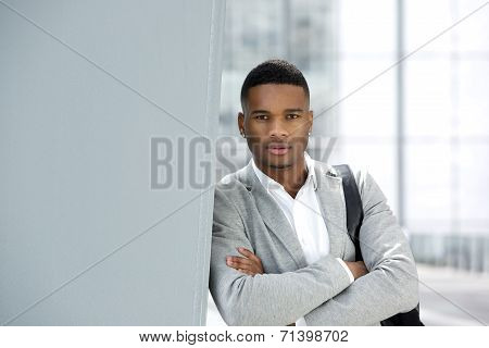 Handsome Young Man Posing With Bag At Airport