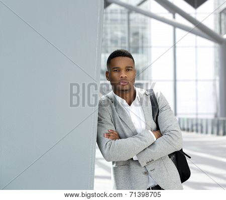 Young Man Standing In Airport With Bag
