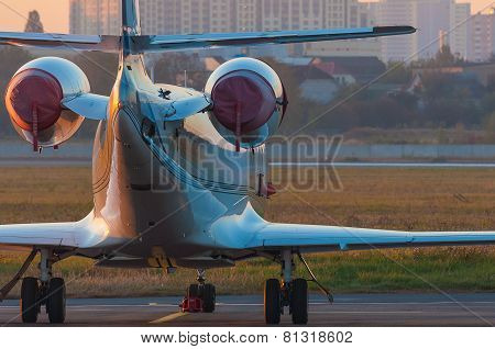 Business jet on the apron of aircraft. Dawn at airport