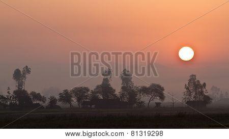 wonderful sunset on a tharu village, Bardia, Nepal