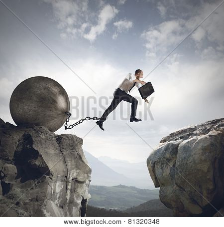 Businessman jumps the obstacle