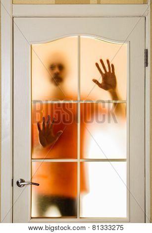 Man Behind The Glass Door