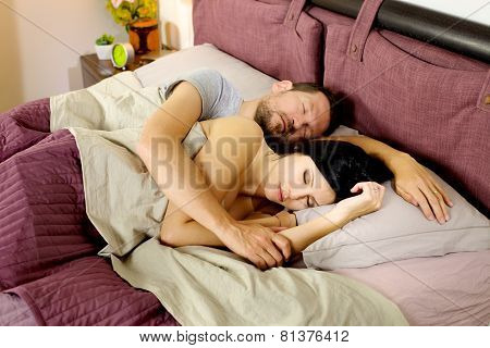 Happy Couple Relaxing In Bed In The Morning