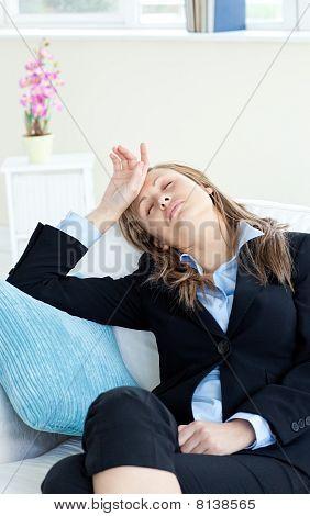 Stressed Businesswoman Sleeping On A Sofa