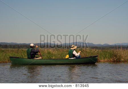Couple Paddling Canoe