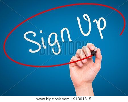 Man Hand writing Sign Up with marker on transparent wipe board.