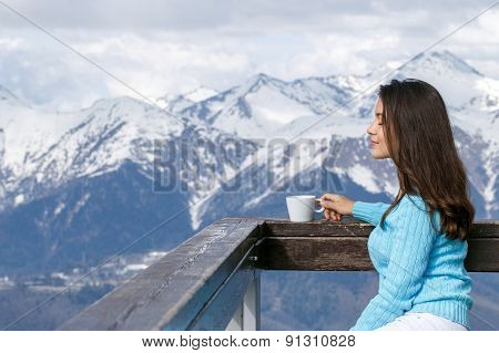 Beautiful Woman Joyful Cup Of Tea On Snow Mountains