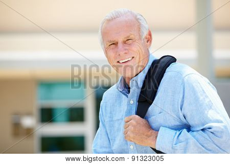 Portrait senior man sitting outdoors