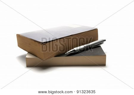 stack of book and pen isolated on a white background