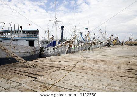 Makassar schooners (pinisi) in Paotere harbor, the old port of Makassar,  Indonesia poster
