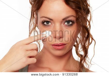 Woman Is Wearing A Face Cream