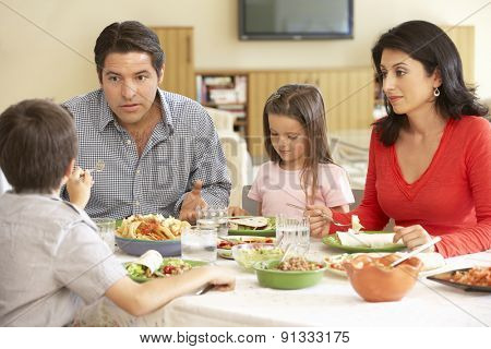 Young Hispanic Family Enjoying Meal At Home poster