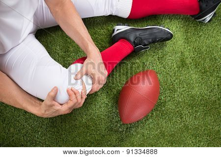 American Football Player With Injury In Leg