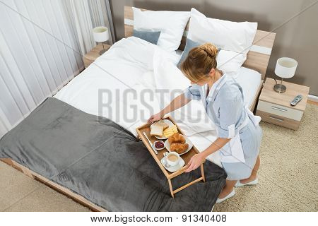 Maid With Breakfast Keeping On Tray Table