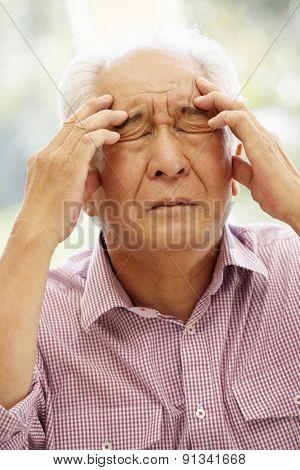 Senior Asian man with headache