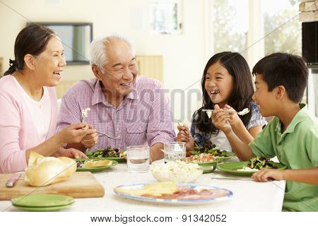 Asian family sharing meal at home poster