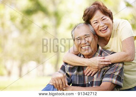 Portrait senior Asian couple in park