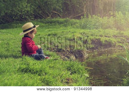 Cute Child Playing By The Water