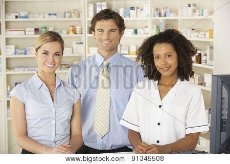 Nurse working on computer in pharmacy