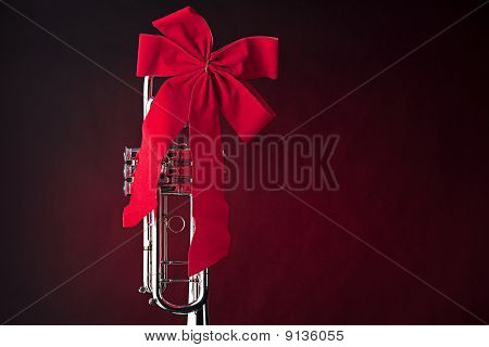 Silver Trumpet With Red Bow On Red