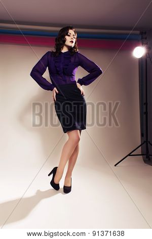 Beautiful Brunette Woman In Dark Skirt And Blouse With Evening Make Up And Waves Retro  Hairstyle. F