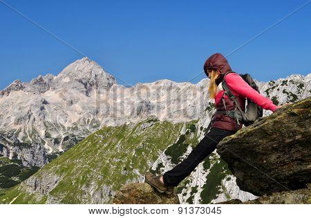Girl on rock, in the background mount Triglav - Julian Alps, Slovenia