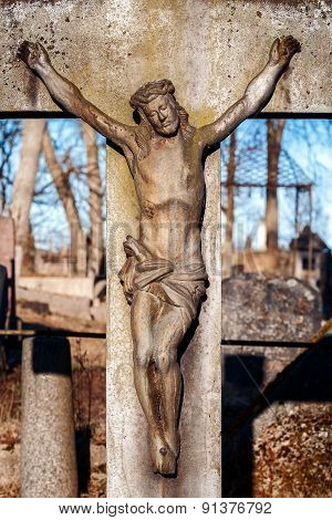 Statue of crucified Jesus Christ at Rasu cemetery in Vilnius Lithuania poster