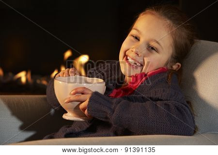 Portrait 7 year old girl by firelight
