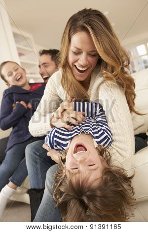 Parents playing with children at home