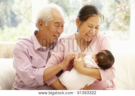 Asian grandparents with baby poster