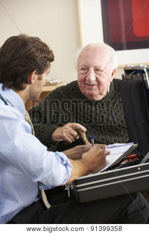 Doctor visiting senior man at home
