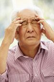 Senior Asian man with headache poster