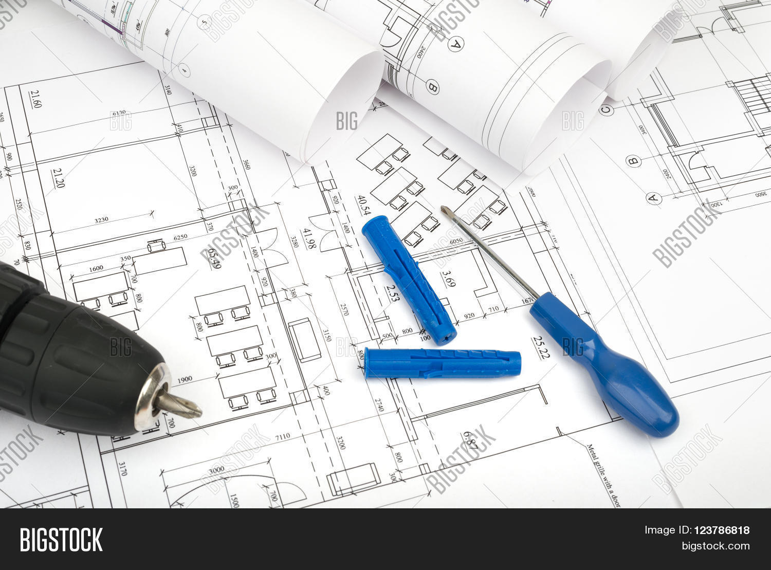 Architecture plan image photo free trial bigstock architecture plan and rolls of blueprints with scredriver and electric screwdriver building concept malvernweather Images