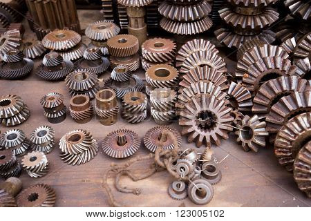 Colorful shot of metal wheel textures and other metal details in Vietnamese metal market (Cho Sat)