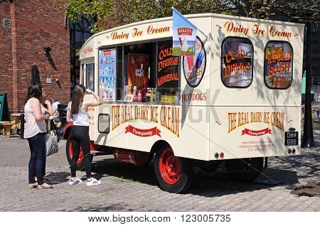 LIVERPOOL, UK - JUNE 11, 2015 - Tourists buying ice cream from an ice cream van Liverpool Merseyside England UK Western Europe, June 11, 2015.