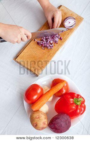 Woman Cutting Onion On White