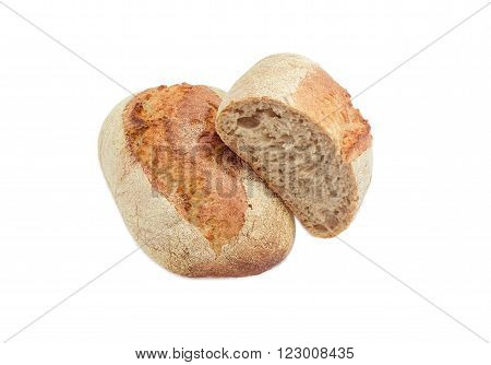 One whole loaf and one half loaf of wheat unleavened bread with bran on a light background