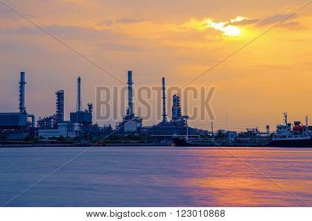 Distillation tank of oil refinery, Sunrise time. Bangkok, Thailand